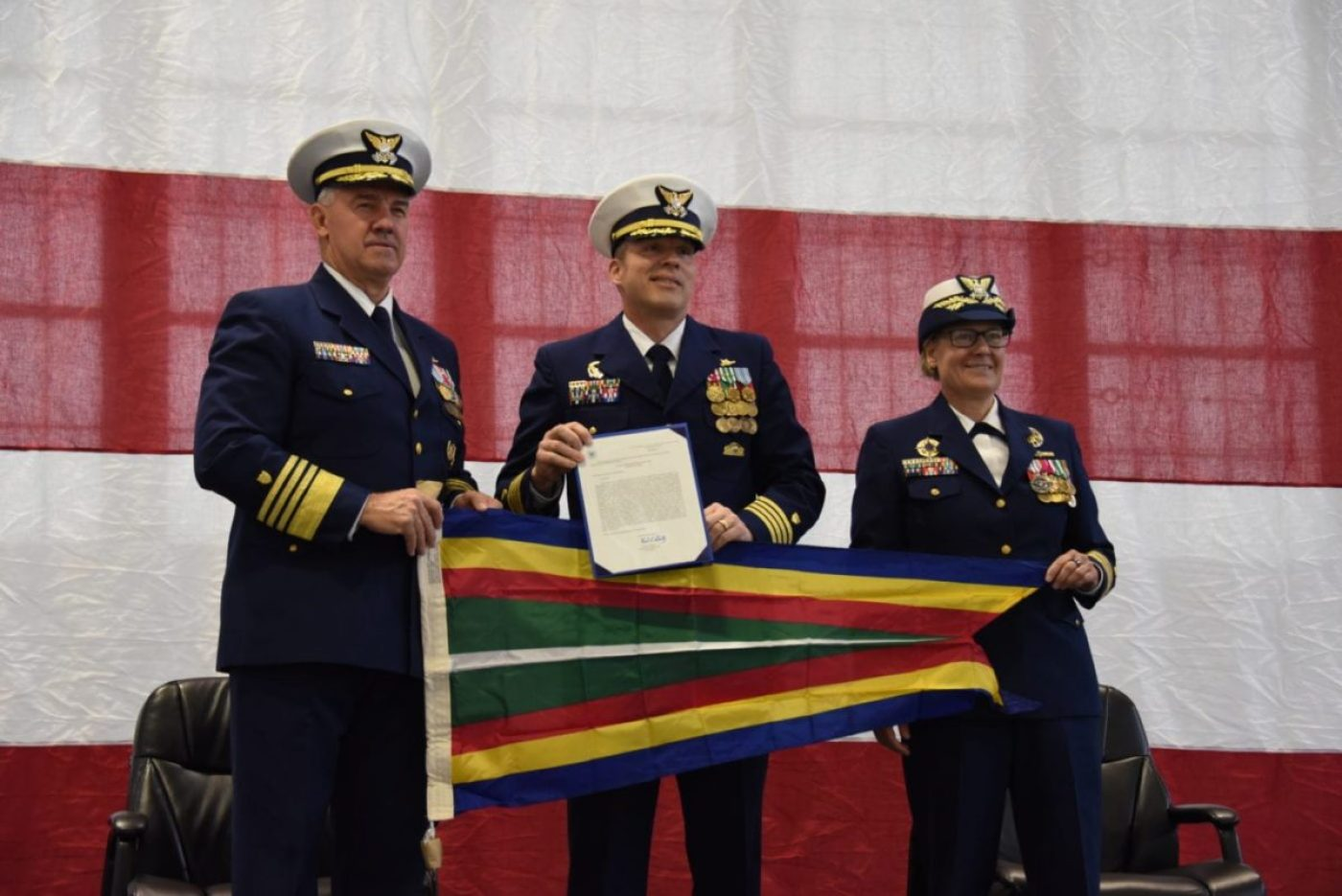 Coast Guard Commandant Adm. Karl L. Schultz, Vice Adm. Linda Fagan, and Capt. Riley Gatewood, hold a pennant during the Coast Guard Cutter Douglas Munro (WHEC 724) decommissioning ceremony in Kodiak, Alaska, on April 24, 2021. In 1998, the cutter interdicted over 11.5 tons of cocaine on a Mexican flagged vessel, the Xolesuientle, to this day one of the largest single drug seizures in Coast Guard history. Coast Guard photo by Petty Officer 3rd Class Janessa Warschkow