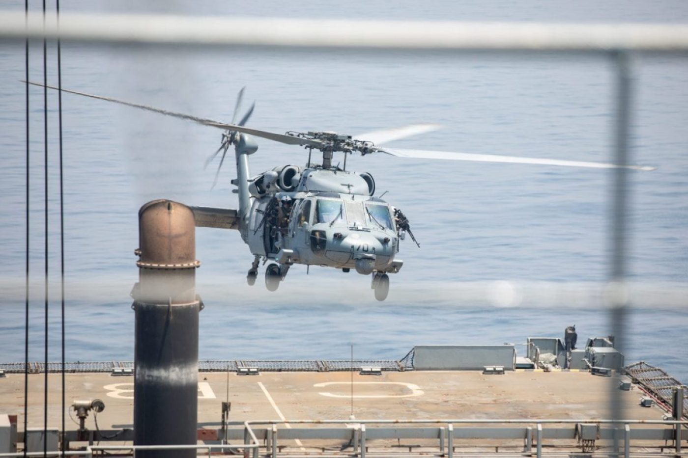 """A MH-60S Sea Hawk helicopter, attached to the """"Chargers"""" of Helicopter Sea Combat Squadron (HSC) 26, lands on the flight deck of Royal Fleet Auxiliary landing ship dock RFA Cardigan Bay (L 3009) during flight operations as part of exercise Artemis Trident 21 in the Arabian Gulf, April 26. (U.S. Army photo by Sgt. Wheeler Brunschmid)"""