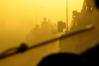 In this photo from 2012, U.S. and Afghan Air Force security forces members navigate through morning traffic, as they head to the firing range for weapons training. (U.S. Air Force photo/Tech. Sgt. Quinton Russ/RELEASED)