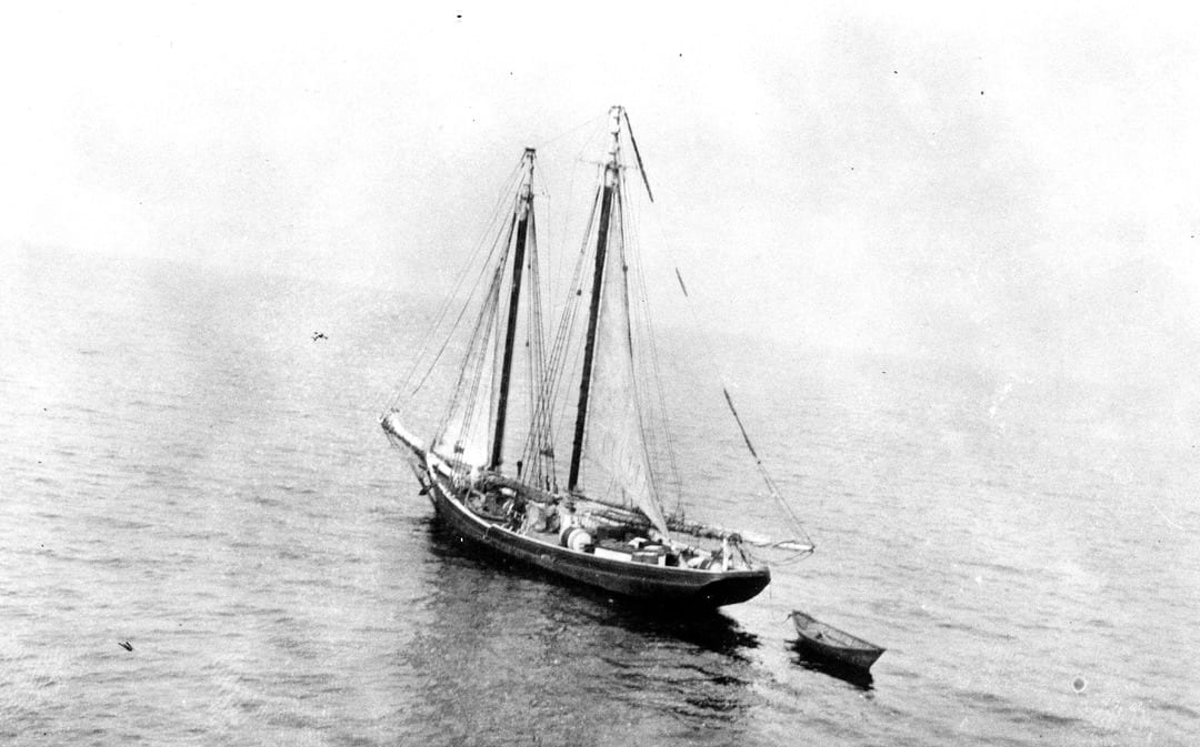 """A rum-running """"mother ship"""" at anchor in international waters, filled with alcohol that would be smuggled in by smaller, faster """"contact boats,"""" the Prohibition equivalent to today's """"go-fasts."""" (U.S. Coast Guard photo)"""