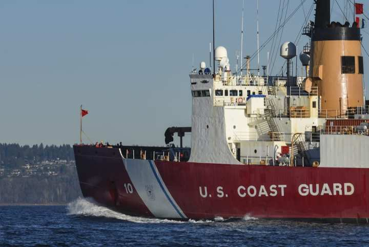 U.S. Coast Guard Cutter Polar Star (WAGB 10) transits the waters of Puget Sound near Seattle on Dec. 4, 2020. The crew was deploying on a rare wintertime mission to the Arctic Circle. (U.S. Coast Guard photo by Petty Officer Steve Strohmaier)