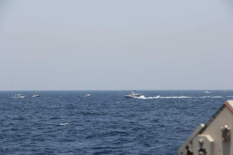 Two Iranian Islamic Revolutionary Guard Corps Navy (IRGCN) fast in-shore attack craft (FIAC), a type of speedboat armed with machine guns, conducted unsafe and unprofessional maneuvers while operating in close proximity to U.S. naval vessels transiting the Strait of Hormuz, May 10, 2021. U.S. forces exercised lawful defensive measure after the IRGCN vessels ignored repeated verbal and acoustic warning and closed toward Maui at a high speed and close distance with weapons uncovered and manned. (U.S. Navy photo)