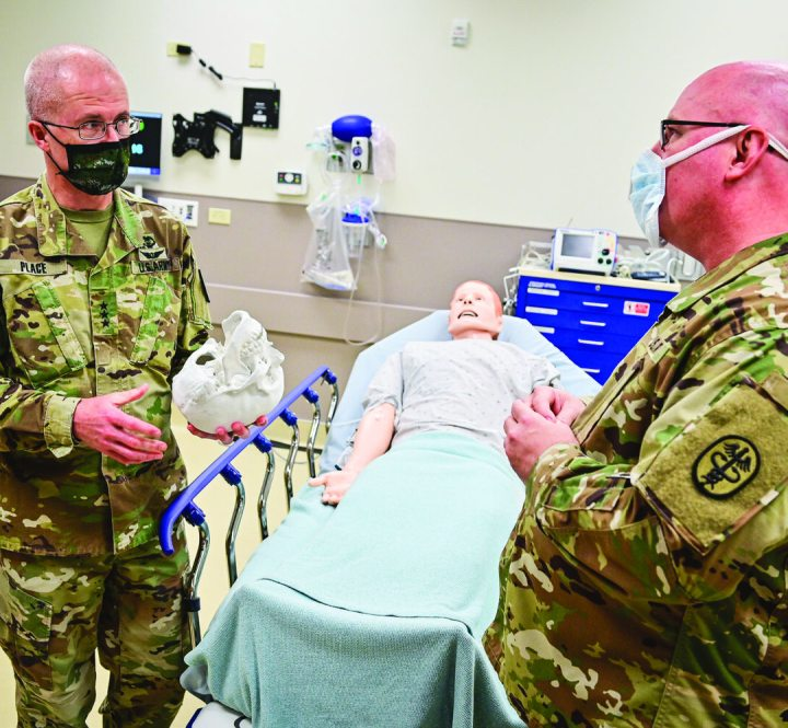 Lt. Gen. Ronald J. Place (left) meets with Col. Dwight Kellicut, chief of vascular surgery at Tripler Army Medical Center, in Hawaii.