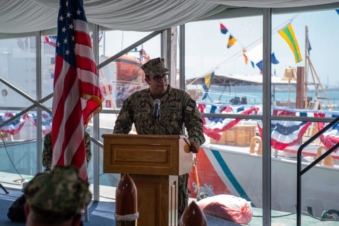 Lt. Benjamin Williamsz, commanding officer of USCGC Adak (WPB 1333), delivers remarks during the decommissioning ceremony for Adak and USCGC Aquidneck (WPB 1309) onboard Naval Support Activity Bahrain, June 15. Adak and Aquidneck operated in the U.S. 5th Fleet area of operations since 2003 in support of Operation Iraqi Freedom, Enduring Freedom, Inherent Resolve and Spartan Shield. (U.S. Navy photo by Mass Communication Specialist 3rd Class Dawson Roth)