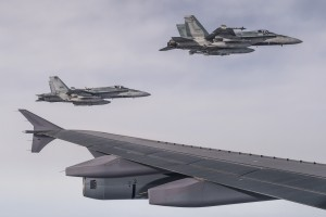 Two CF-18 Hornets escort a CC-150 Polaris after being refueled during Operation IMPACT on February 4, 2015. (Photo: Canadian Forces Combat Camera, DND)