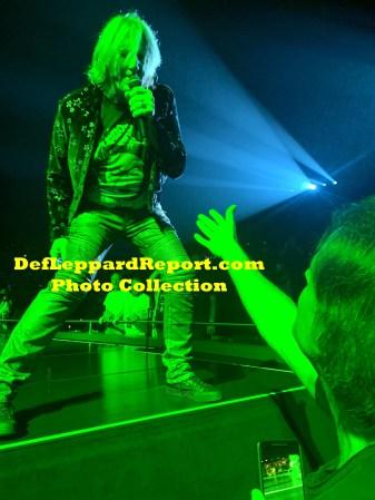 Joe Elliott on stage hand slap