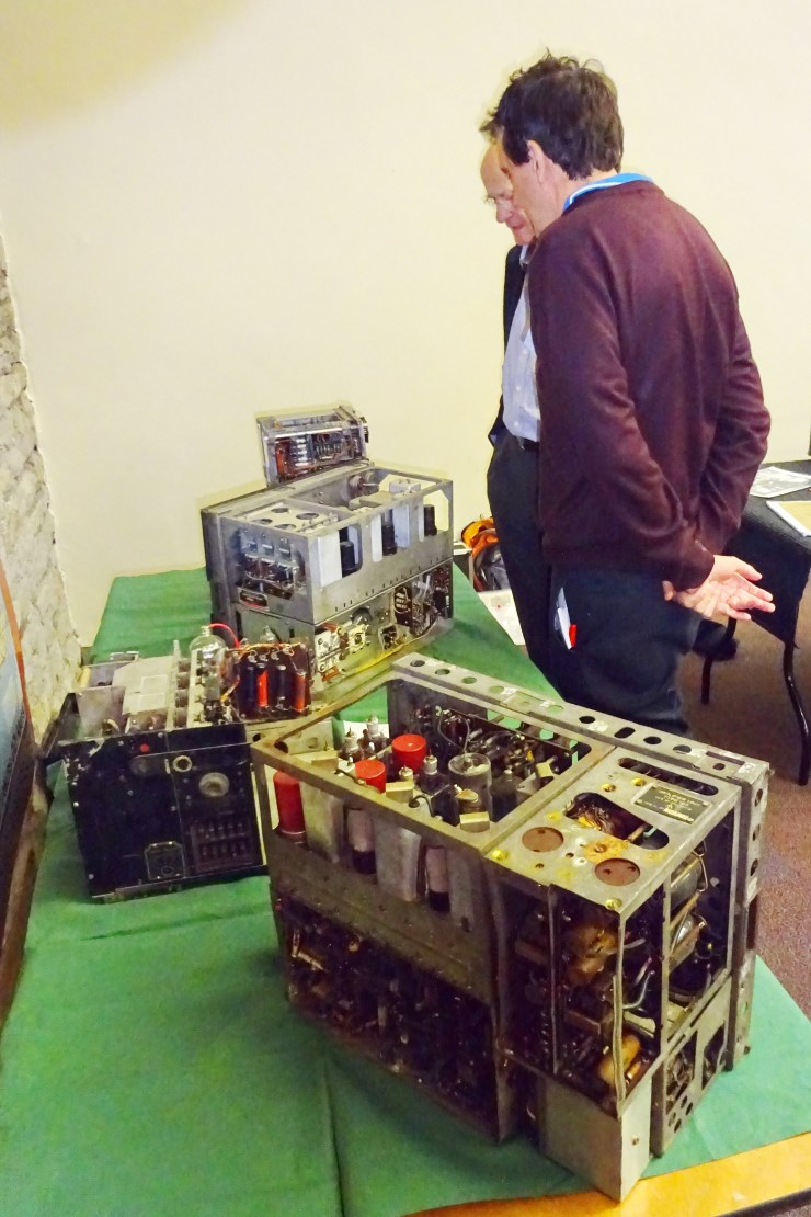 DEHS Burns Spring Lecture 2019 equipment display: Perusal of VHF technology development - back of UK TR1143 foreground, US SCR 522 behind, German FuG 16 to rear (Phil Judkins). Photo by Dick Green.
