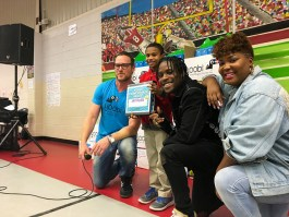 Yoobi, Shamiek Moore and Tiff McFierce pose with Hambrick student
