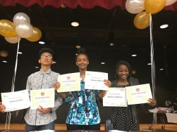 three students hold certificates