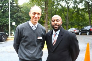 John West and Dr. Zack Phillips smile while standing