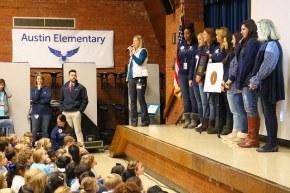 austin teachers stand on stage