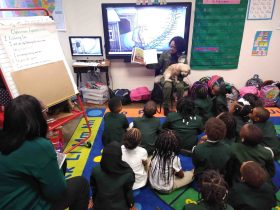 Sharon Liner-Ervin reads to students on carpet