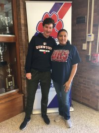Noah Covey with counselor DeRoux