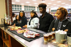 five students look at food on counter