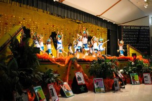 students performing dance on stage