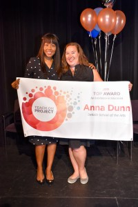 Anna Dunn holds banner with previous winner