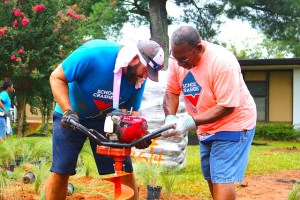 volunteer and Dr. Green dig hole