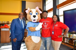 Mr. Hines stands with superintendent and principal