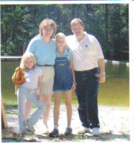 (From left to right) Ashley, Peg, Christy and Tracy Schnyer in front of Lake Agape a few years ago