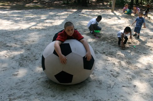 The giant soccer ball is good for more than just kicking.
