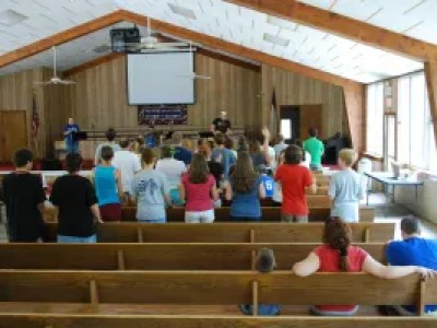 "Junior High 1 2009 group having some fun singing (and shouting) ""Romans 16:19"", which says, ""Everyone has heard about your obedience, so I am full of joy over you; but I want you to be wise about what is good, and innocent about what is evil."""