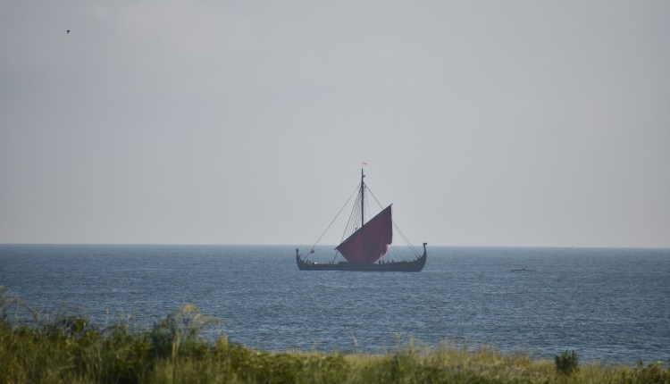 Draken Harald Hårfagre putting up her sail and heading out to sea on her way to Ocean City, Maryland