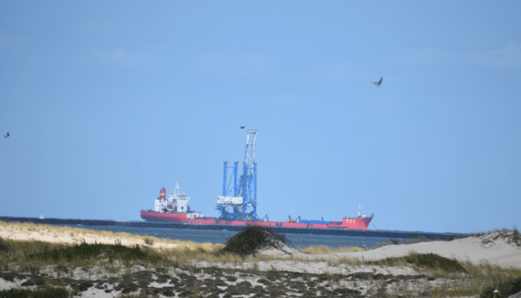 Zhen Hua 26 heavy lift vessel with the super-post-Panamax crane on board off Lewes Delaware