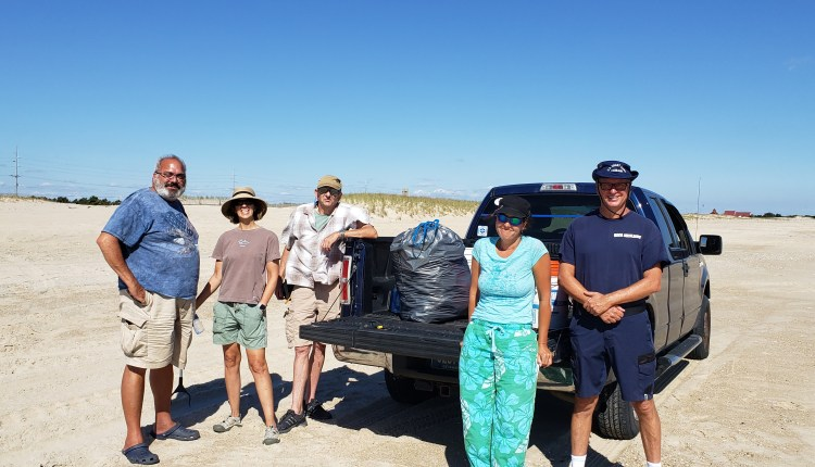 Some of today's  beach clean up volunteers and a big bag of trash.
