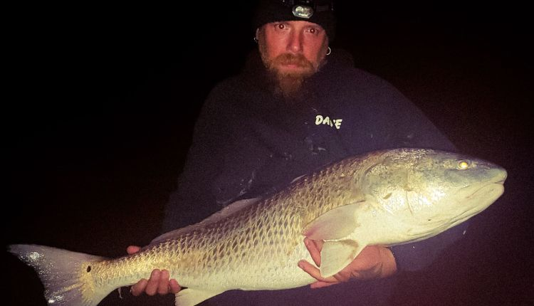 Dave Moore with one of the three bull reds he caught
