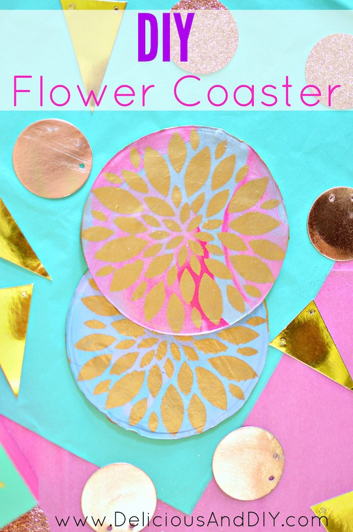 Circle Clay Coasters with a gold flower stenciled onto it