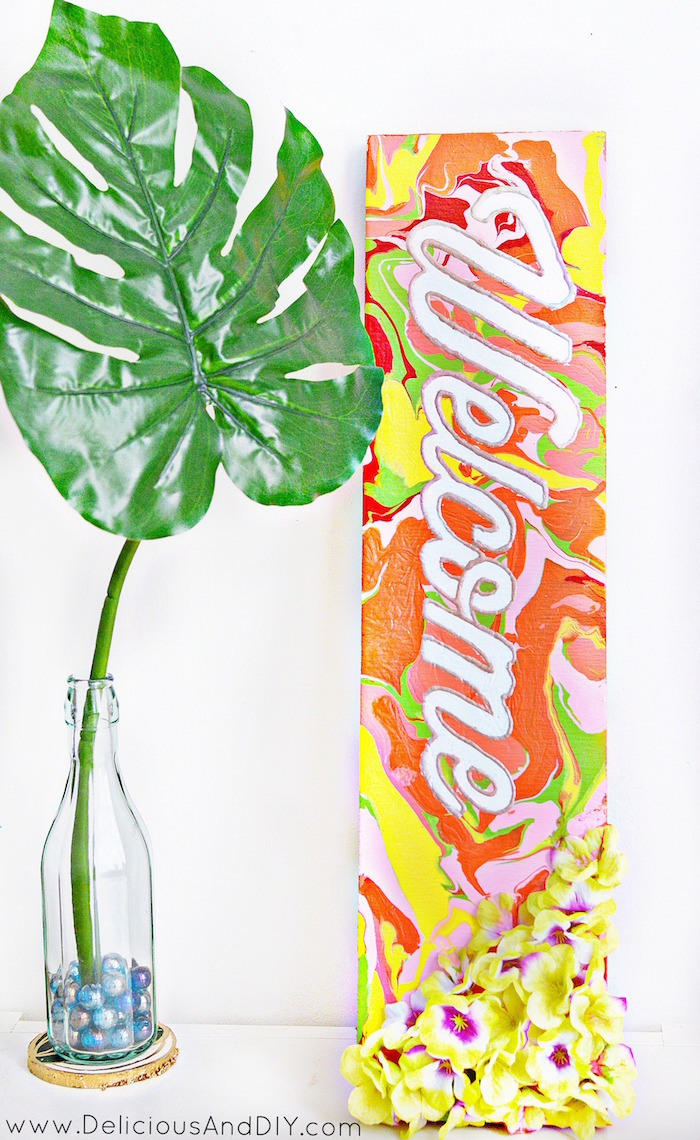 Create this bright and bold Marbled Welcome Sign by using multiple paint colors, stencil and some Artificial Flowers| Welcome Home Sign| Painted Welcome Sign