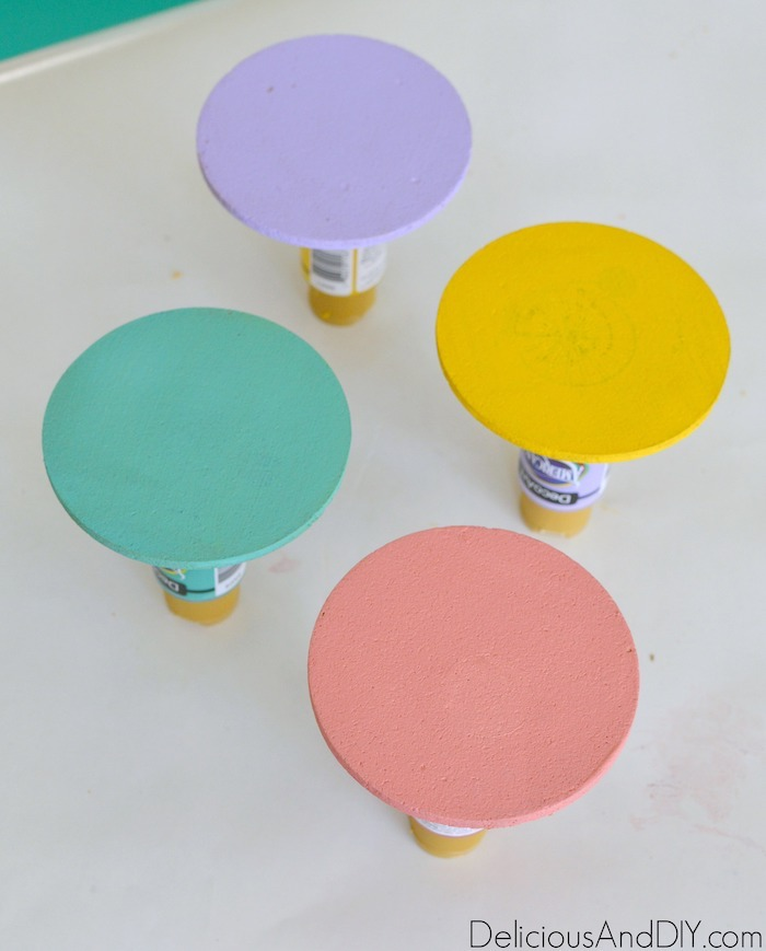 cork coasters painted in pastel colors