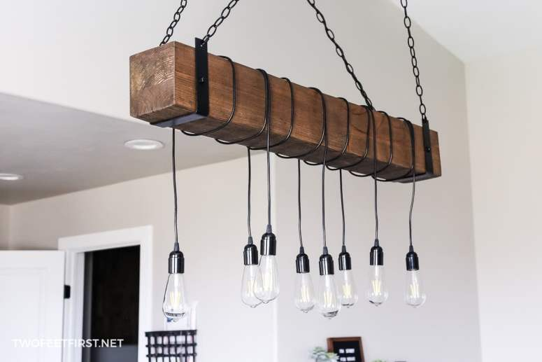 A charming way to upgrade your home is to create this DIY Wood Beam Chandelier perfect for your home decor space.