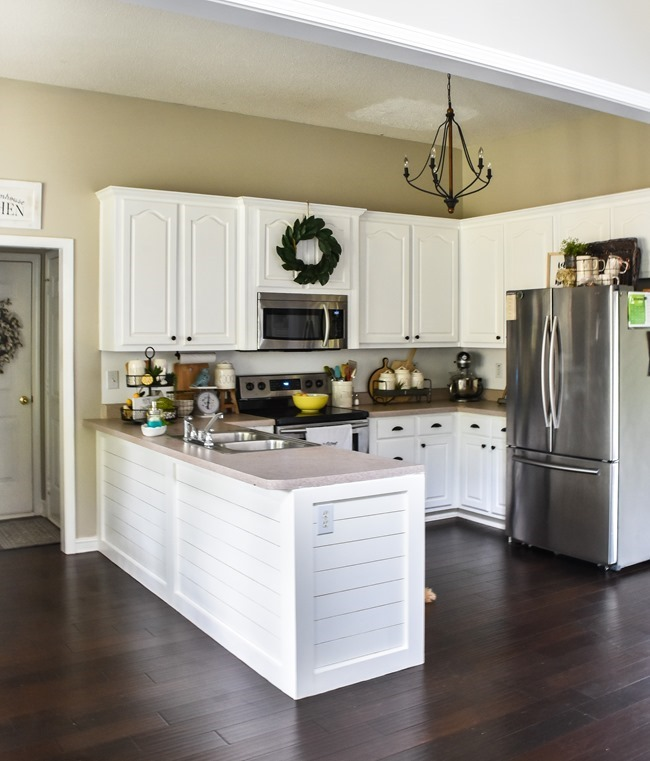 A beautiful way to add character to a kitchen peninsula by using the shiplap method, a great upgrade to your home.