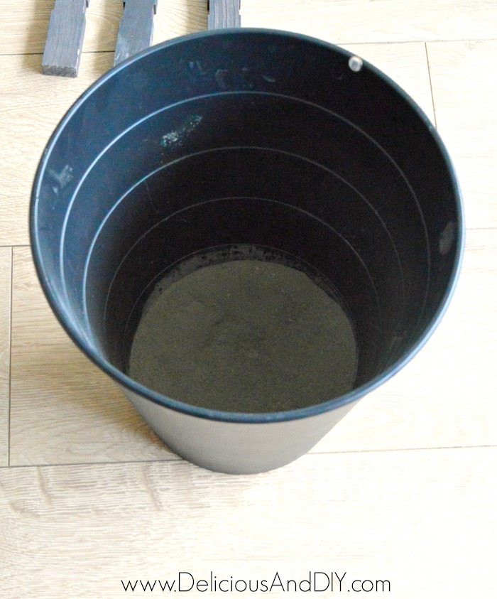Dry Concrete in a plastic round bin ready to be mixed with water
