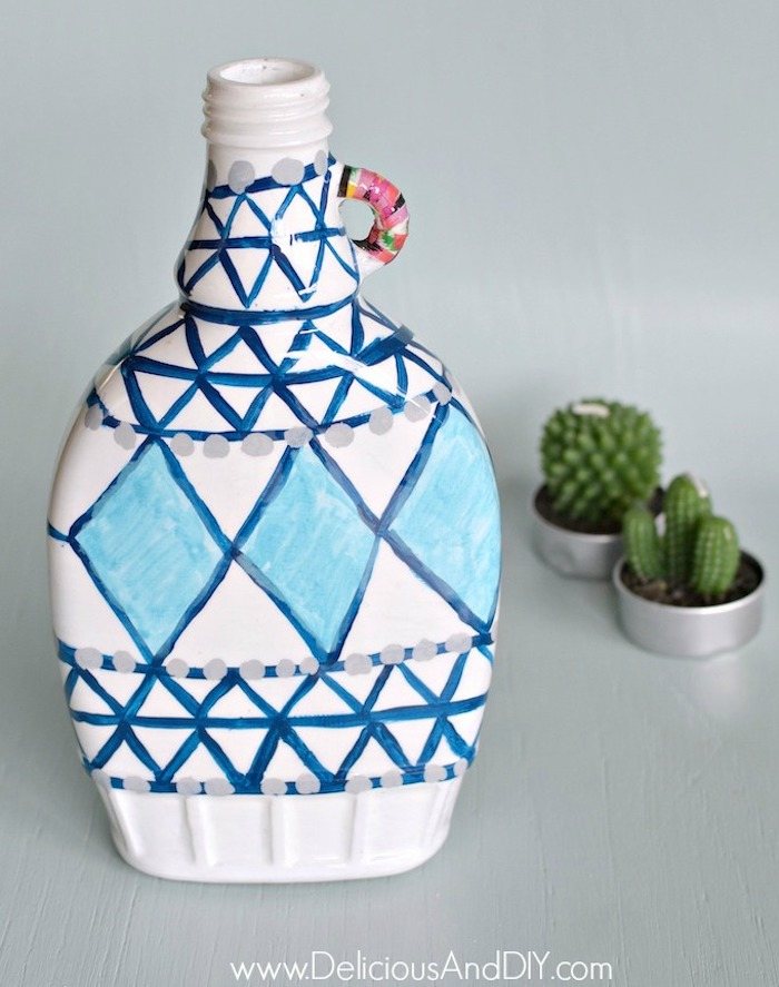 A plain bottle hand painted in blue and white paint colors