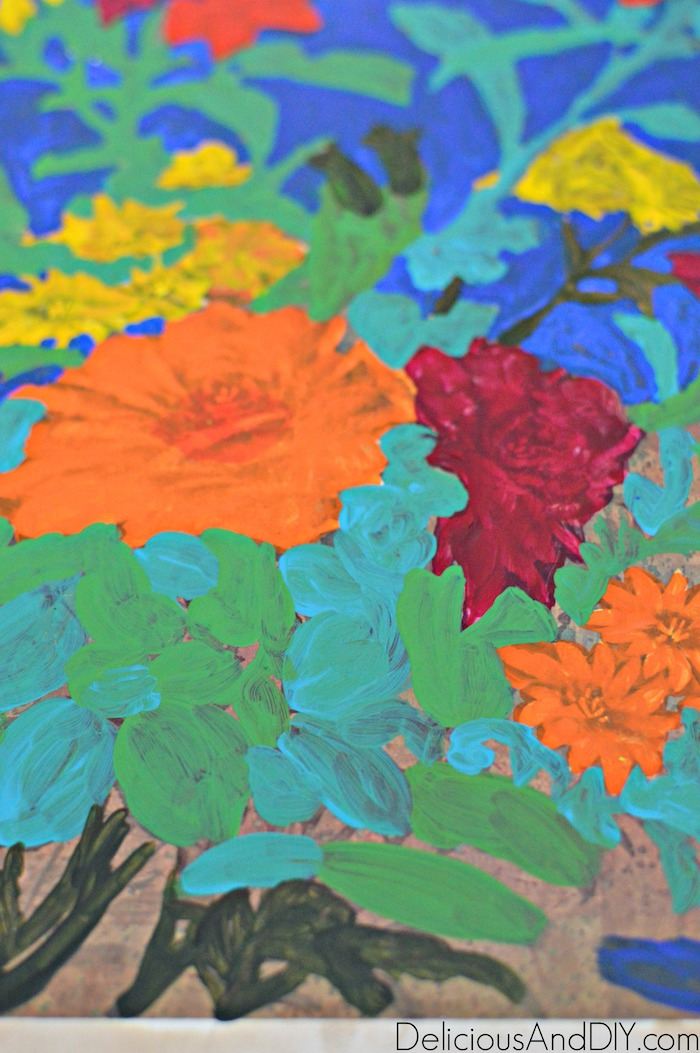 Painting over the design of the thrift store art using acrylic paints