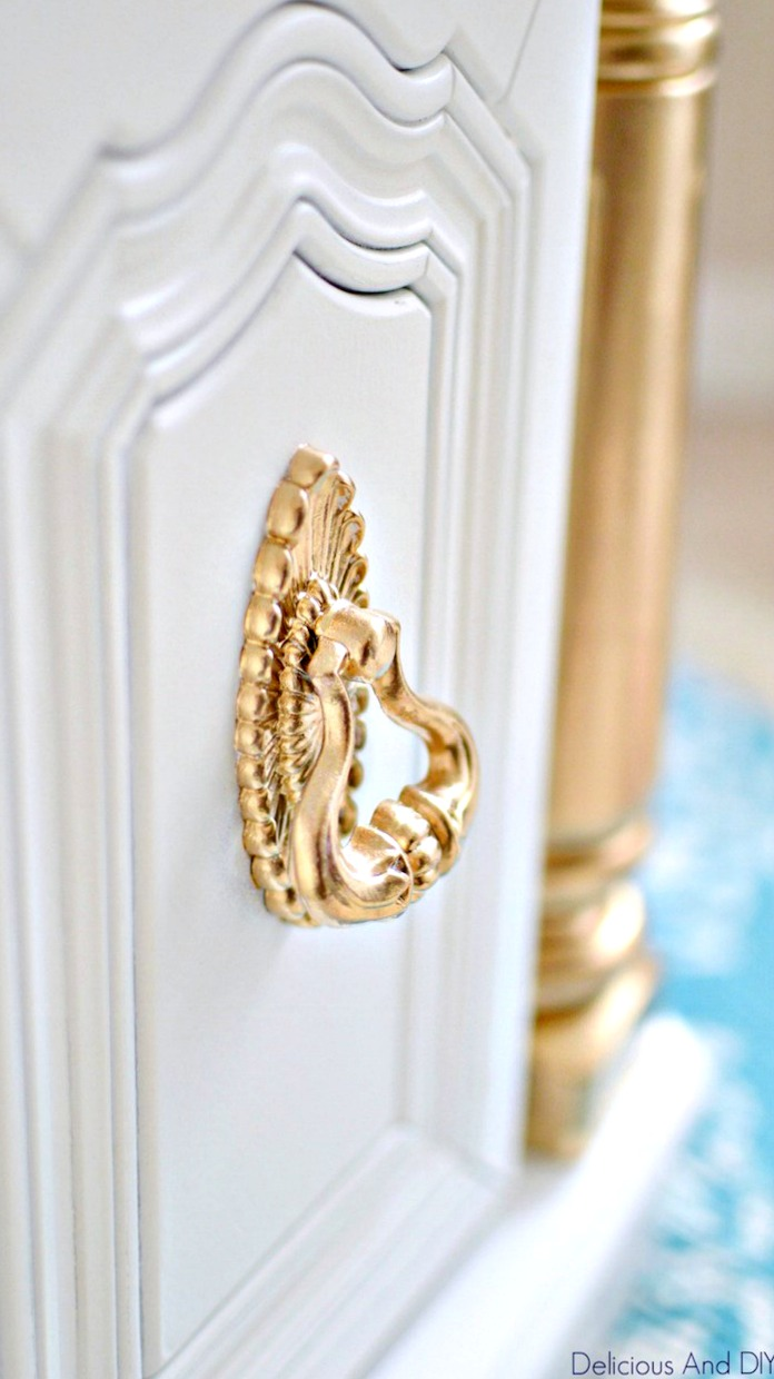 A close up picture of Gold painted Drawer Pull
