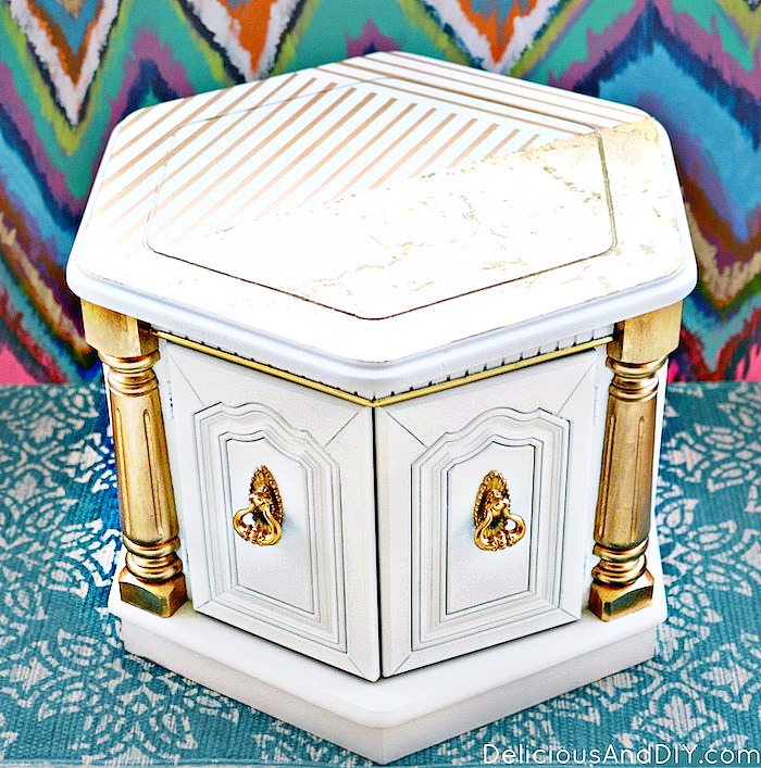 Hexagon Shaped Coffee Table with Gold Accents and Gold Stripes on Top