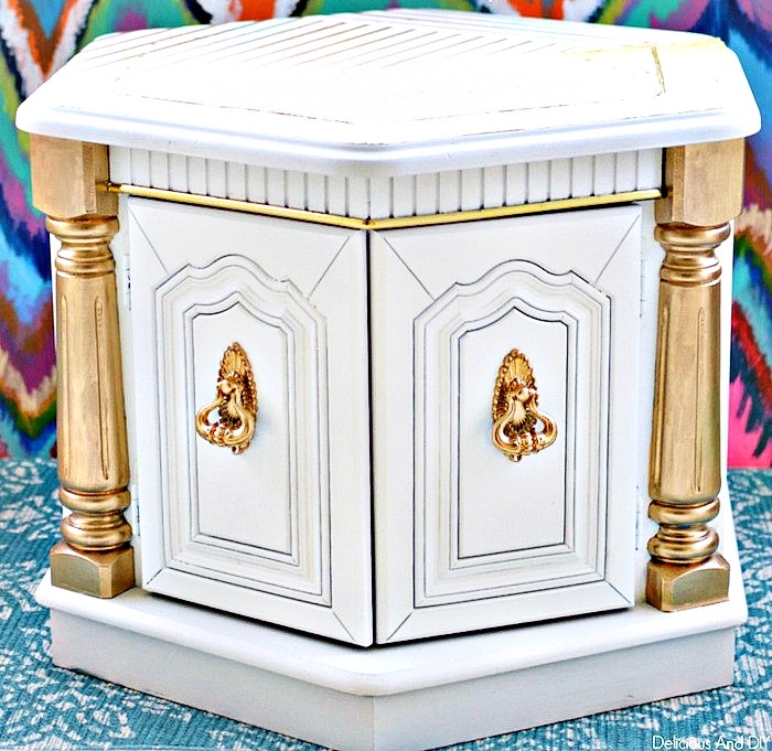 A white and Gold Hexagon shaped Coffee Table with Gold Accents