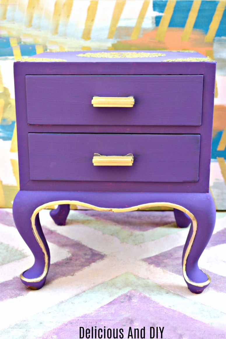 a thrifted nightstand painted using purple chalk paint