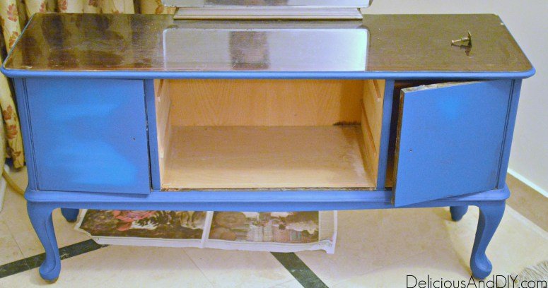 vanity dresser being painted with turquoise chalk paint