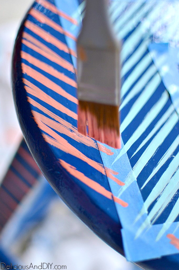 painting brushstroke patterns onto the bar stool