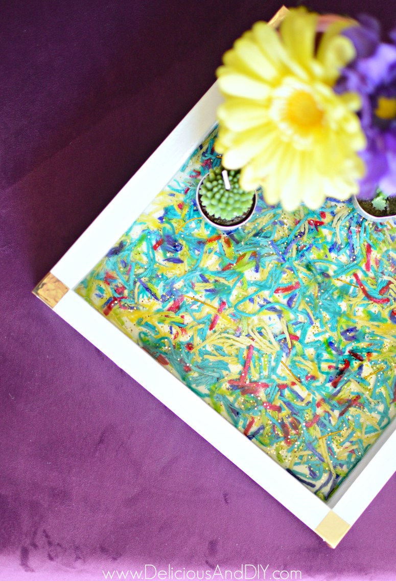 a stunning wooden tray transformed by using epoxy resin and yarn