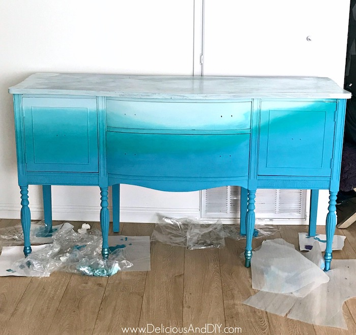 Blending the three paint colors on the buffet table