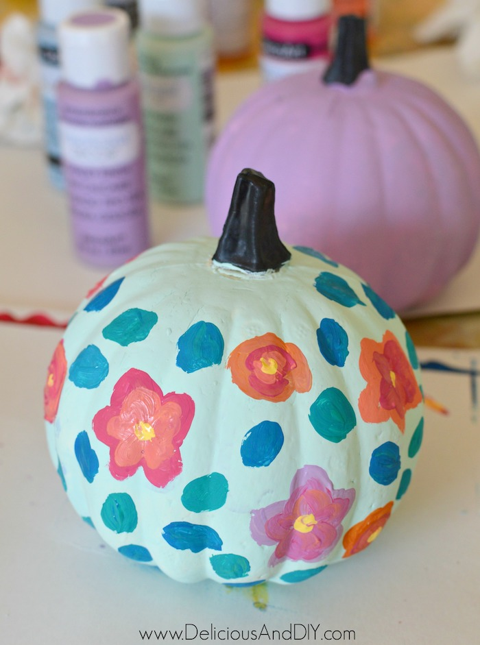 painting leaves onto dollar store foam pumpkin
