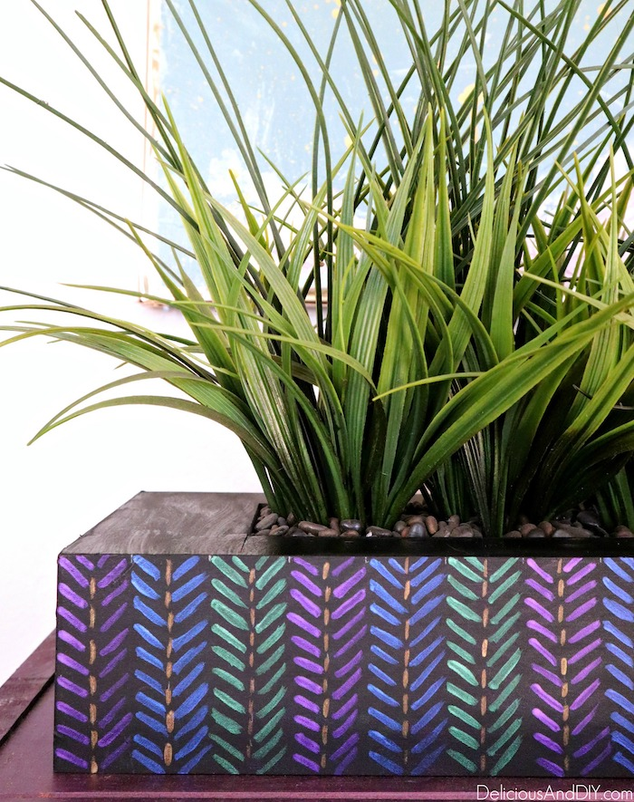 painted aztec planter with colorful arrows