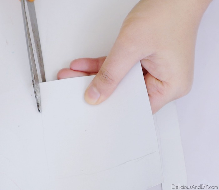 cut a square piece with scissors