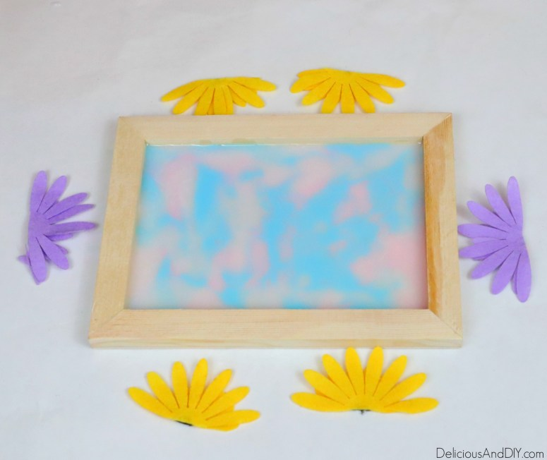 felt flowers being cut and about to be placed into the tray