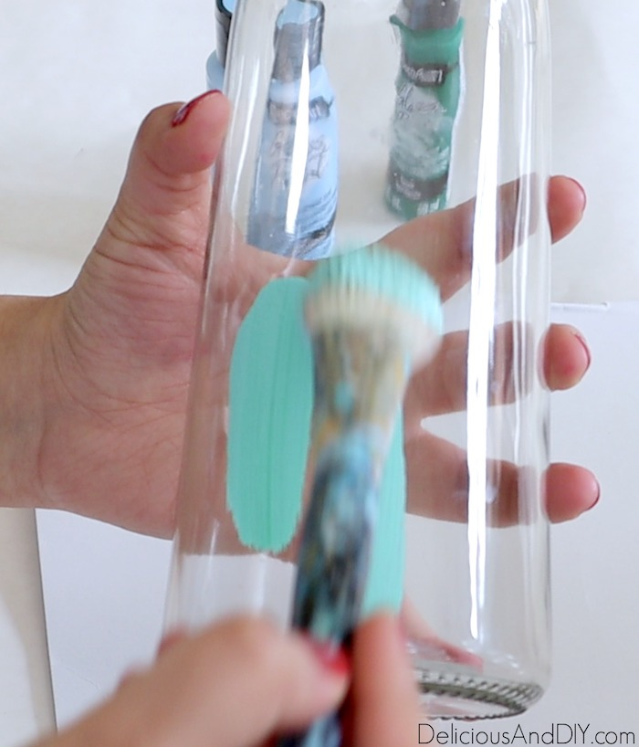 green glass paint being painted onto dollar store vase